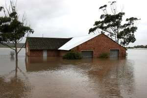 bigstock-Flooded-House-On-River-Bank-20892065
